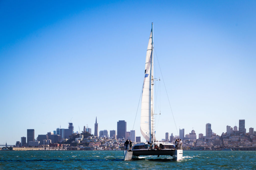 Adventure Cat sailing on the San Francisco Bay, the city skyline in the background