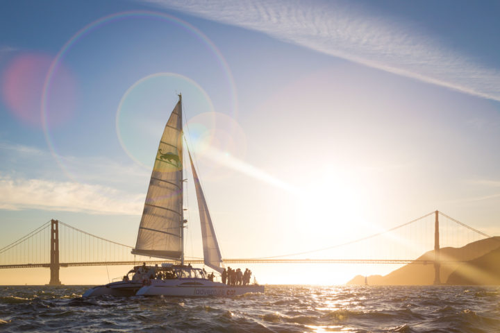Adventure Cat sailing on the San Francisco Bay, Golden Gate bridge in the background