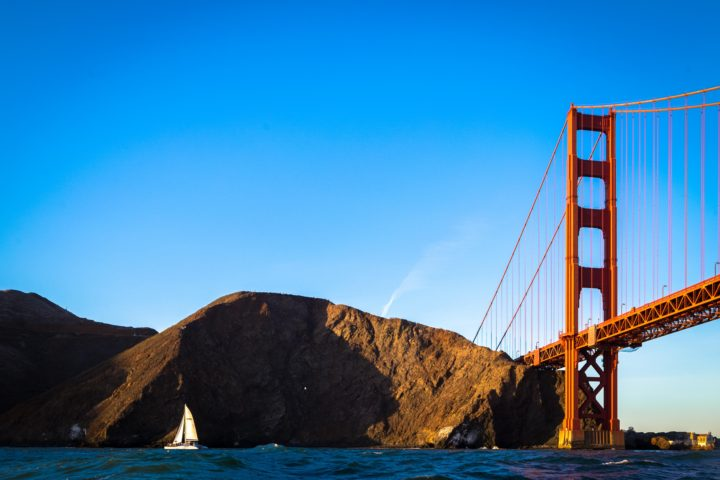 Adventure Cat sailing near the Marin Headlands, Golden Gate Bridge in the background