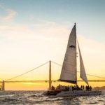 Adventure Cat sailing near the Golden Gate bridge at sunset