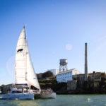 Adventure Cat sailing next to Alcatraz Island
