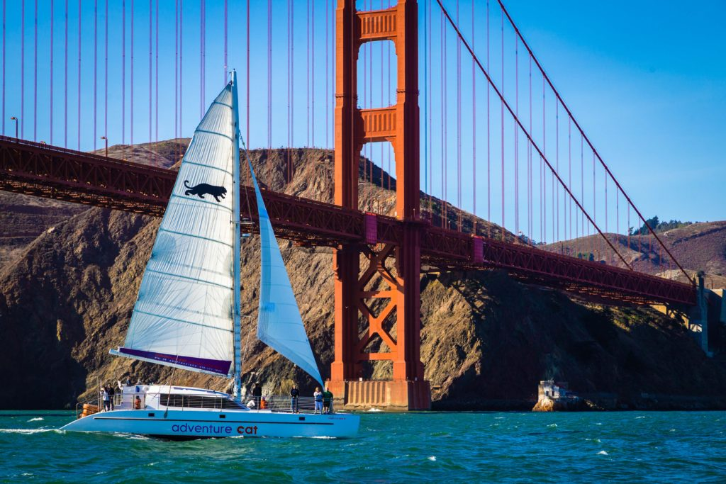 Adventure Cat sailing towards the city, Golden Gate and Marin Headlands in the background