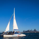 Adventure Cat sailing on the San Francisco Bay with the city skyline