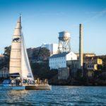 Adventure Cat sailing in front of Alcatraz Island