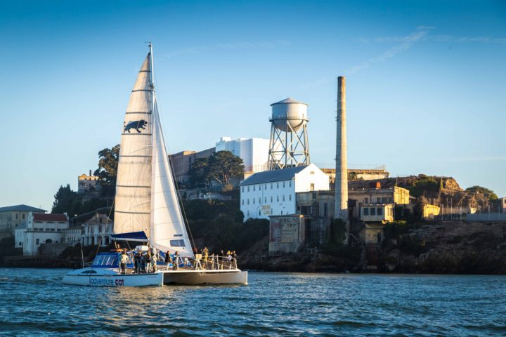 Adventure Cat sailing in front of Alcatraz Island