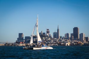 Adventure Cat sailing in front of the San Francisco city skyline