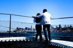 sailing couple looking at San Francisco cityfront skyline