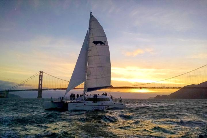 Adventure Cat sailing just after sunset